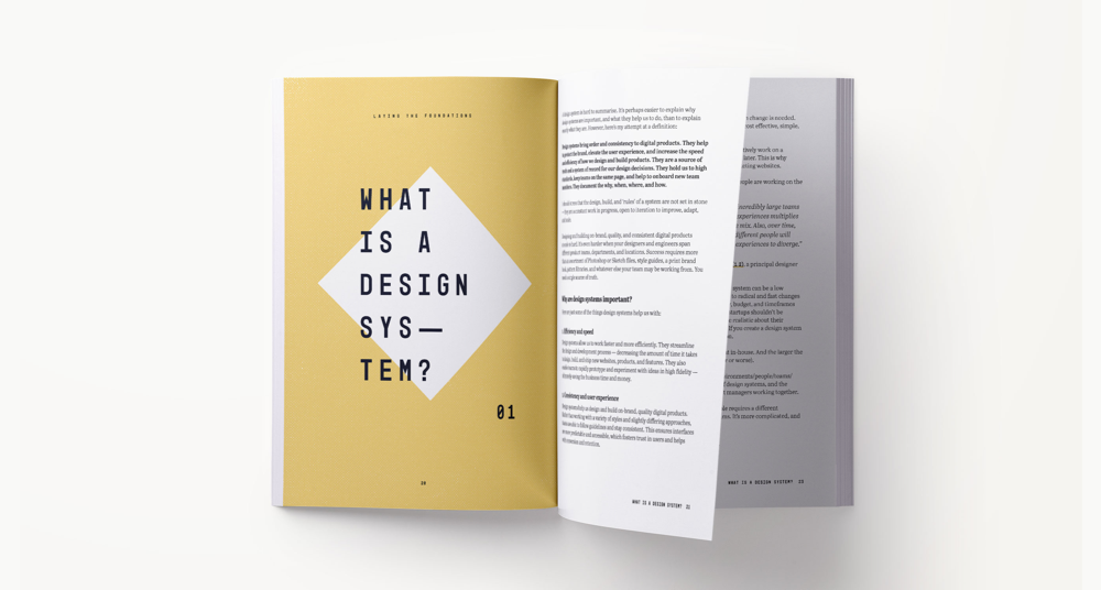 A design systems book spread showing content related to what a design system is